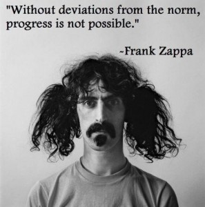 "A picture of Frank Zappa with his hair tied in crazy pigtails and the quote ""Without deviation from the norm, progress is not possible."""